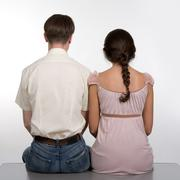 rear view of dates sitting next to each other over white background - stock photo