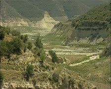 Cyprus drought - Kouris dam wide empty river bed leading to the dam 16:9 PAL Stock Footage