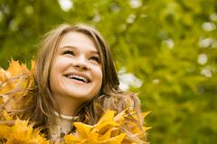 portrait of face of joyful woman in autumnal environment - stock photo