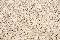 Image of splitting ground of desert with many cracks Stock Photos