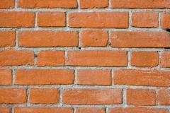 background of red brick lines composing wall - stock photo