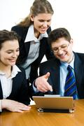 Image of confident business people looking at monitor of laptop Stock Photos
