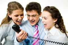 portrait of three business people screaming on the telephone - stock photo
