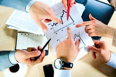 Image of hands showing the document at workplace Stock Photos
