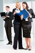 Portrait of business women holding the document and standing in front Stock Photos