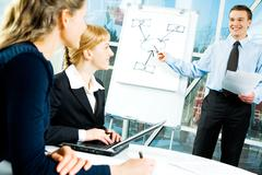 Photo of confident speaker giving a presentation at business meeting Stock Photos
