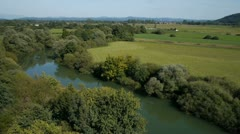 AERIAL: River and fields Stock Footage