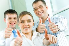 Image of business people showing sign of okay Stock Photos