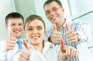 Stock Photo of image of business people showing sign of okay