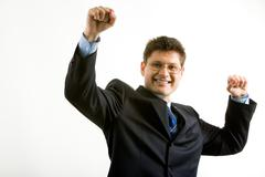 Portrait of happy businessman in suit raising his hands Stock Photos