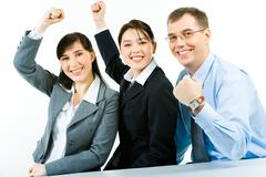 Conceptual photo of business team holding their fists up meaning power of work i Kuvituskuvat
