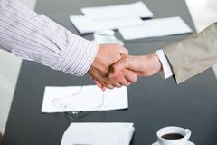 Image of successful partnership of people being confirmed by handshake Stock Photos