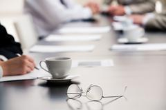 Image of  glasses placed on the table during a seminar Stock Photos