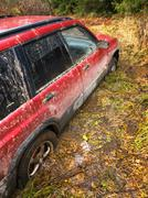 closeup of a stuck suv in mud - stock photo
