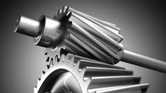 Close up of spinning steel silver chrome cogs gears pinions or engine parts. - stock footage