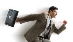 portrait of energetic businessman carrying briefcase and running - stock photo