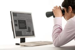Photo of white collar worker with binoculars looking at monitor of computer Stock Photos