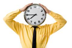 portrait of businessman's hands touching clock placed instead of head - stock photo