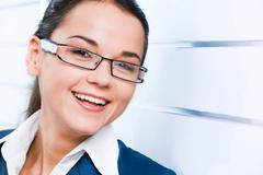 Face of business woman with smile isolated on a white background Stock Photos