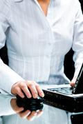 image of businesswoman touching a computer mouse - stock photo