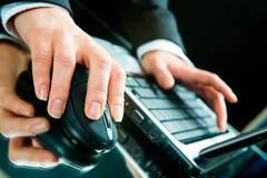 Photo of hands typing a letter on the laptop Stock Photos