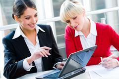 Portrait of two successful business women working together Stock Photos