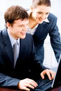 Portrait of two confident business people working together Stock Photos