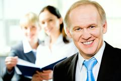 Stock Photo of portrait of confident adult business man looking at camera