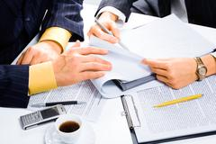 Image of people's hands during business conversation at meeting Stock Photos