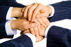 Photo of human hands on top of each other isolated on a white background Stock Photos