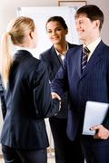 business people making a perfect bargain with the partner - stock photo