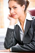 Portrait of thoughtful business woman putting a chin on her hand Stock Photos