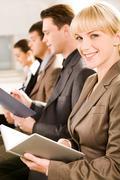 image of business woman glancing at camera during a seminar - stock photo
