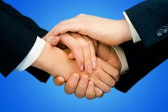 Pile of human hands isolated on a blue background Stock Photos