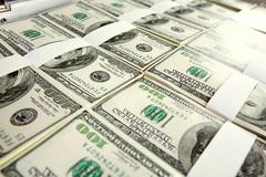 close-up of million dollars made from lots of hundred bills - stock photo