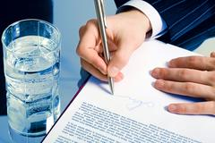 businessman' signing a contract - stock photo