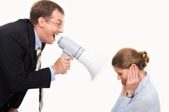 Image of angry boss screaming by megaphone on his secretary Stock Photos