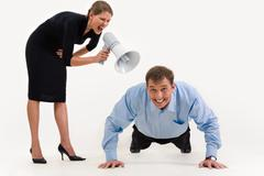 Image of businesswoman standing and screaming at businessman doing a exercise Stock Photos