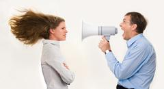 Image of strict boss shouting at businesswoman through loudspeaker so loudly tha Stock Photos