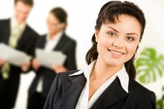 portrait of successful businesswoman in working environment in office - stock photo