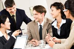 Portrait of five business people discussing a project at briefing Stock Photos