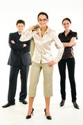 image of business-team with female leader standing in front - stock photo