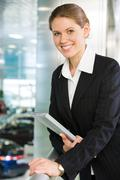 photo of smart business lady touching balcony railing and looking at camera with - stock photo