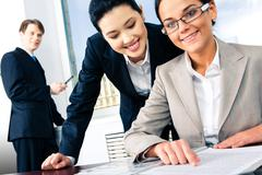 image of two business women working together in the office - stock photo