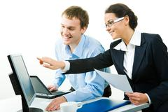 view of businesswoman pointing at computer explaining business-plan to her colle - stock photo