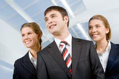 image of business group of three perspective people looking away from camera - stock photo