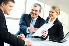 senior boss giving business instructions - stock photo