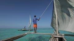 Outrigger sailing boat on the coast of Zanzibar. Tanzania. Stock Footage