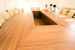 Photo of business people sitting at table in the boardroom and working together Stock Photos