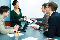 Photo of friendly business team working in the office around the table Stock Photos